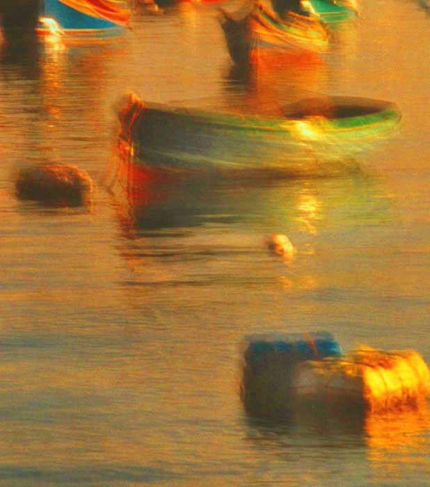 Gold float, green boat, Malta