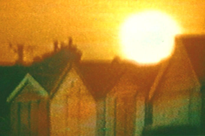 Beach huts, big sun setting